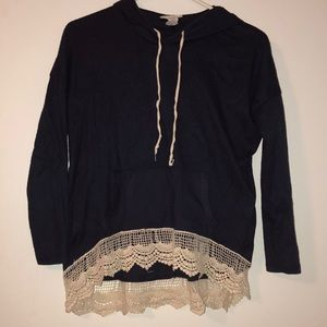Navy blue hooded shirt with cream lace trim.